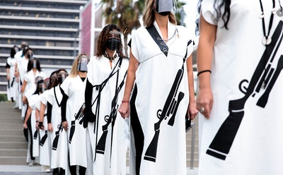 Outfitted With Symbolic Rifles, Female Collective Raises Awareness for a Largely Ignored War