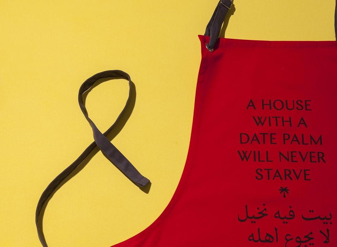 """""""A House With A Date Palm Will Never Starve"""" Apron"""